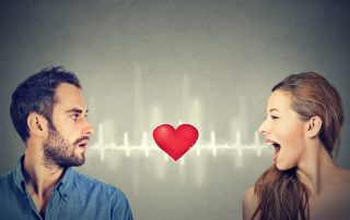 Love connection. Man woman talking to each other with red heart in-between